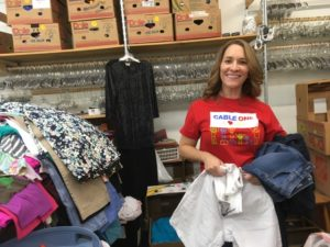 Cable One Advertising volunteering at Stepping Stones thrift
